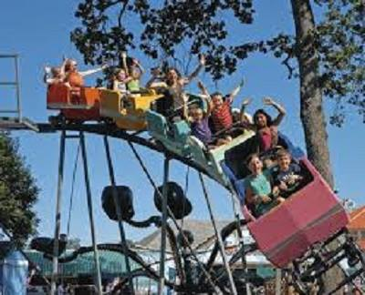 Kids on a roller coaster at Oaks Park